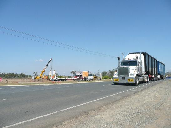 Earthmoving Equipment & Crane and Road Train on busy Somerset Road